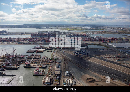 helicopter aerial view of GCT Bayonne container terminal and surrounding piers, Bayonne, Jersey City, New Jersey, USA - Stock Photo