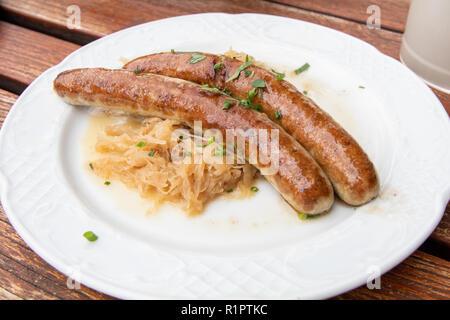 Bratwurst and sauerkraut German dish - Stock Photo