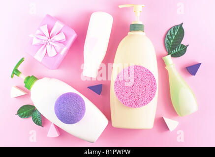 Cosmetic packaging plastic bottle shampoo cream shower gel milk green leaves sponge box gift bow. Natural organic product skin and hair care shopping. - Stock Photo