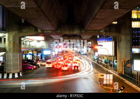 SEPTEMBER 25, 2018 : BANGKOK, THAILAND - Long Exposure from cars light at Ratchaprasong, Siam intersection night scene - Stock Photo