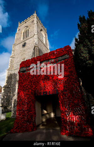 Arrangement of wool poppies on The Church of St Michael in Framlingham, Suffolk to commemorate  Remembrance Day - Stock Photo