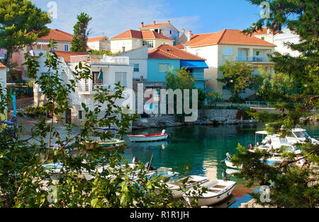 Cozy picturesque town of Bozava, Dugi otok, Croatia. Small colorful houses near emerald green water where boats and yachts are floating. Everything fr - Stock Photo