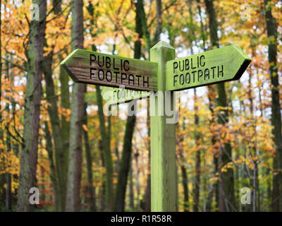 Public footpath signpost in autumn woodland at Hornbeam Park Harrogate North Yorkshire England - Stock Photo
