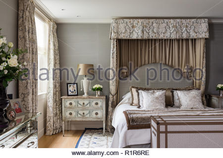Canopy bed in luxurious bedroom - Stock Photo