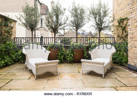 White armchairs on patio - Stock Photo