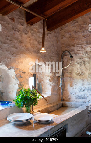 Sink in rustic kitchen - Stock Photo