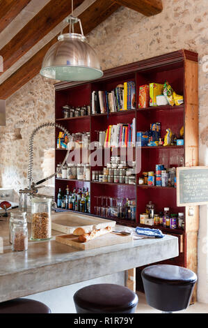 Shelving in rustic kitchen - Stock Photo