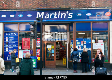 Exterior Of A Combined Martins Newsagents Shop and Post Office - Stock Photo