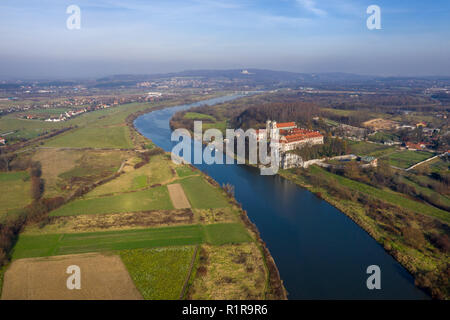 Aerial view of Tyniec Benedictine abbey, Vistula river, Cracow and Silver Mount with Camaldolese Hermit Monastery. Poland, autumn day. - Stock Photo