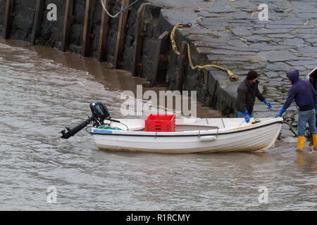 New Quay, UK. 14th Nov, 2018. Blustery and wet morning in New Quay, Wales. Fisherman load their boats up with crates and head off out to sea. Credit: Keith Larby/Alamy Live News - Stock Photo