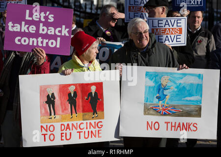 London, UK: 3On the day that Prime Minister Theresa May petitions her cabinet on the current negotiations to leave the EU, Brexiters opposite Downing Street in Whitehall, protest that Leave Means Leave, on 14th November 2018, in London, England. Photo by Richard Baker / Alamy Live News - Stock Photo
