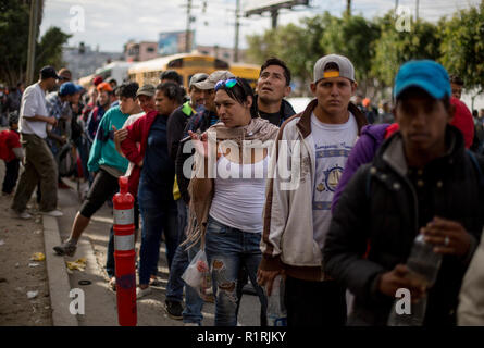Tijuana, Mexico. 13th Nov, 2018. A group of newly arrived migrants queues in the Mexican city of Tijuana to get breakfast. They took a bus from Nayarit for three days. Now several hundred migrants from Central America have reached the border town of Tijuana on their way to the USA. Credit: Omar Martinez/dpa/Alamy Live News - Stock Photo