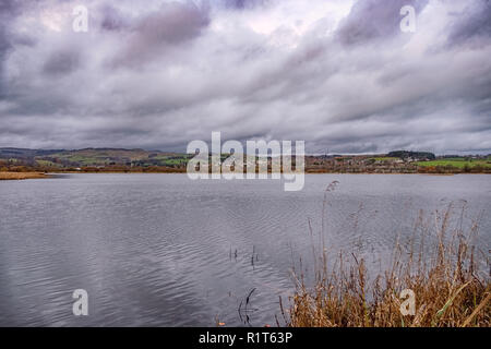 looking out across Castle Semple Loch Lochwinnoch Renfrewshire Scotland on a cold autumn day. Stormy clouds and reflections on the water - Stock Photo