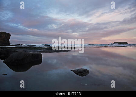 OR02380-00...OREGON - Sunrise at Devil's Punchbowl State Natural Area near Newport. - Stock Photo