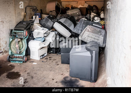 Old electrical appliances in container waiting to be recycled - Stock Photo