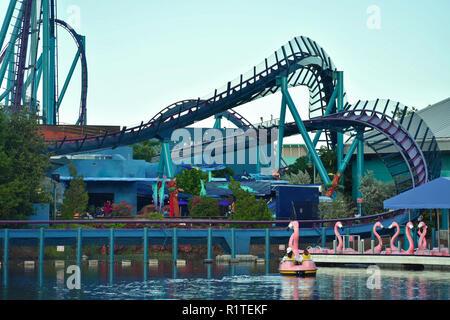 Orlando, Florida. September 29, 2018. Paddle Flamingo boat dock, with Mako Rollercoaster background at Seaworld Theme Park. - Stock Photo