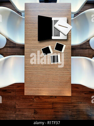 Top view from above on laptop on wooden table, plastic chairs and hardwood floor - Stock Photo