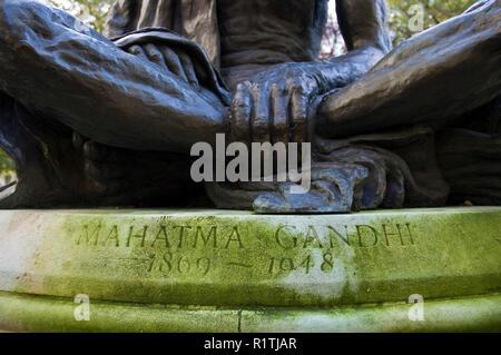 A memorial bronze statue of Mahatma Gandhi stands in Tavistock Square, a public square in Bloomsbury, London. - Stock Photo