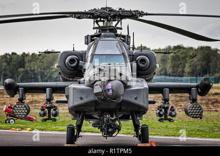 KLEINE BROGEL, BELGIUM - SEP 8, 2018: Royal Netherlands Air Force Boeing AH-64D Apache attack helicopter on the tarmac of Kleine-Brogel Airbase. - Stock Photo