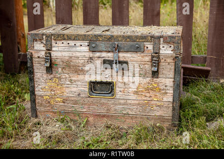 Old wooden storage chest on the grass - Stock Photo