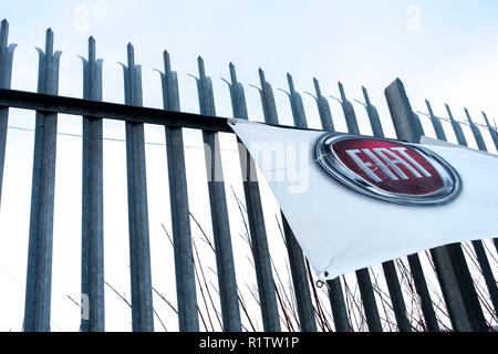 Banner on a fence outside a closed and abandoned FIAT car dealership at Old Pit Lane, Pity Me, Durham, County Durham UK - Stock Photo