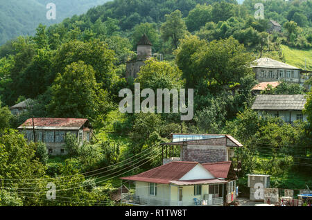 Dilijan, Armenia, August 24, 2018:View of the mountains covered with forest and the chapel of St. Sarkis in the village of gosh, located near the town - Stock Photo