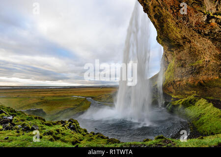Majestic Seljalandsfoss, the most famous waterfall in Iceland. Sunset landscape. Beautiful tourist attraction in one of the main holiday destinations. - Stock Photo