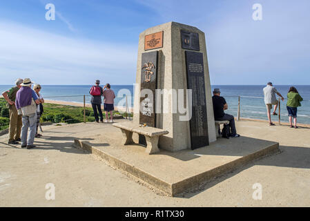 Tourists visiting the Fifth Engineer Special Brigade Memorial at Omaha Beach, Colleville-sur-Mer, Calvados, Normandy, France - Stock Photo