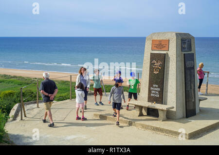 School children visiting the Fifth Engineer Special Brigade Memorial at Omaha Beach, Colleville-sur-Mer, Calvados, Normandy, France - Stock Photo