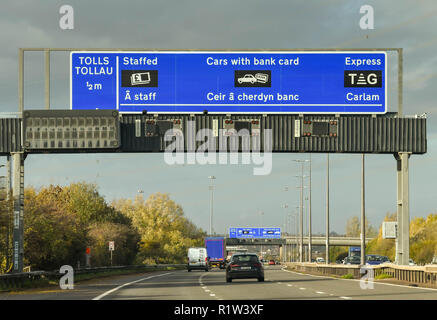 SECOND SEVERN CROSSING, WALES - NOVEMBER 2018: Gantry on the M4 motorway in Wales with information for drivers on paying the toll charges after using  - Stock Photo