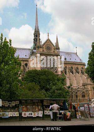 Notre-Dame de Paris, and bouquinistes on Quai de Montebello, Quartier Saint-Victor, Paris, France - Stock Photo
