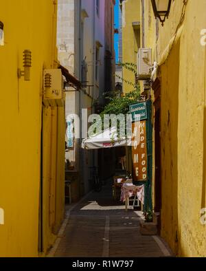 Cafe located on narrow street in old town Rethimno, Crete. - Stock Photo