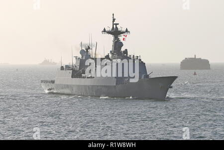 The Korean destroyer ROKS Chungmugong Yi Sun-sin approaching Portsmouth, UK on 11th November 2018 with the support ship Daocheong astern - Stock Photo