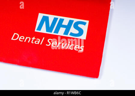 London, UK - November 14th 2018: A close-up of the NHS - National Health Service logo, pictured on an information leaflet about their Dental Services. - Stock Photo