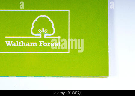 London, UK - November 14th 2018: The logo of the Borough of Waltham Forest in London, pictured on an information leaflet. - Stock Photo