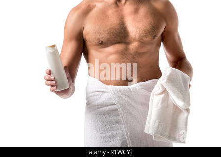 cropped image of muscular shirtless man wrapped in towel holding shower gel isolated on white - Stock Photo
