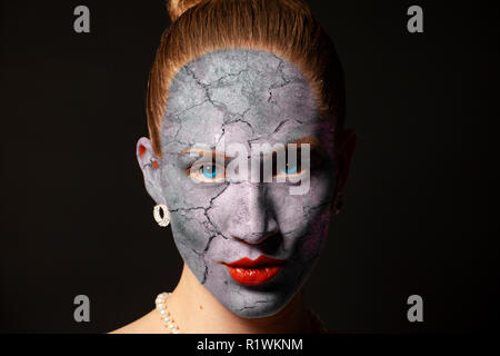 Cracked surface on woman face.Dry skin concept. - Stock Photo