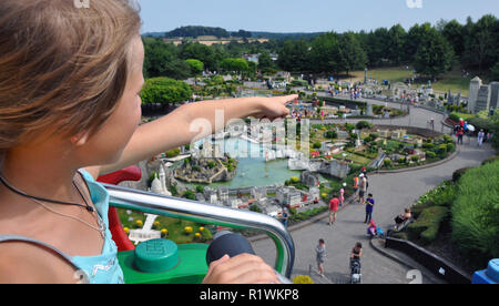Editorial - LEGO miniland in Legoland Windsor theme park. Girl is pointing at her favorite building London Eye all made by bricks in Lego. - Stock Photo