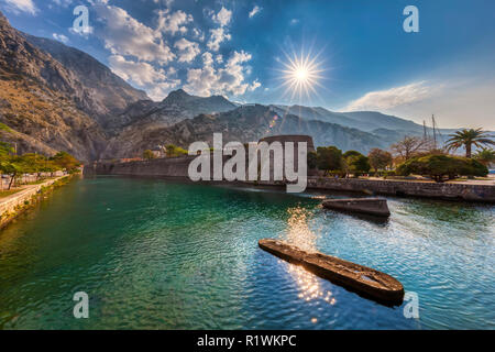 KOTOR, MONTENEGRO - OCTOBER 20: (EDITORS NOTE: Image is a digital [High Dynamic Range, HDR] composite.) The mouth of the Scurda river and the Kampana tower are seen on October 20, 2018 in Kotor, Montenegro. Kotor is one of the oldest towns at the Adriatic Sea, and it is a popular destination of tourists and cruisers.. - Stock Photo