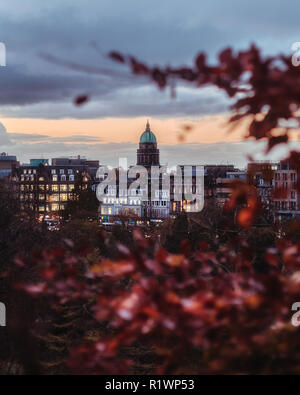Edinburgh, Scotland - November, 2018. View of the West Register House on the Charlotte Square in the New Town of Edinburgh, on the foreground autumn l - Stock Photo