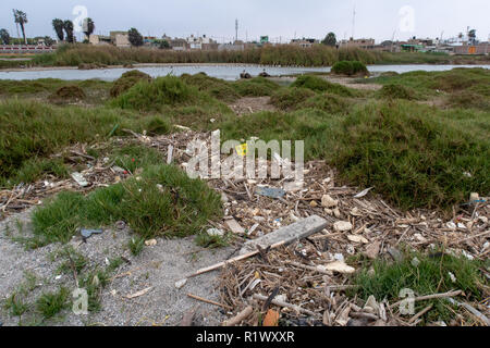 Pisco, Peru - October 19 2018: Plastics and rubbish washed up from the sea onto beaches in Peru causing environmental issues - Stock Photo