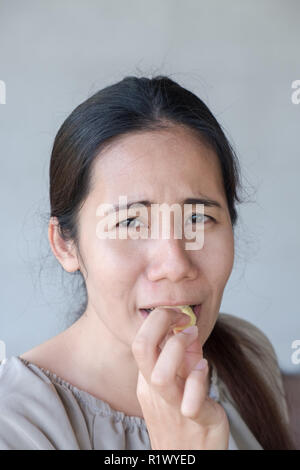 Emotions from the sour on the cute  asian woman face. - Stock Photo