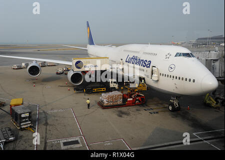 14.10.2014, Hong Kong, China, Asia - A Lufthansa passenger plane is docked at a gate at Hong Kong's International Airport Chek Lap Kok. - Stock Photo