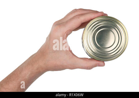 An elderly man holds in his hand a closed can of canned food. Isolated on white studio closeup shot - Stock Photo
