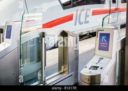 Ticket gates installed on a platform in Paris Gare de l'Est station to control access to an ICE high speed train from german company Deutsche Bahn. - Stock Photo