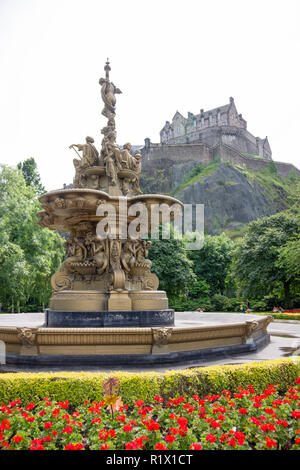 Edinburgh/Scotland - August 2nd 2012: Water fountain with Edinburgh Castle in background - Stock Photo