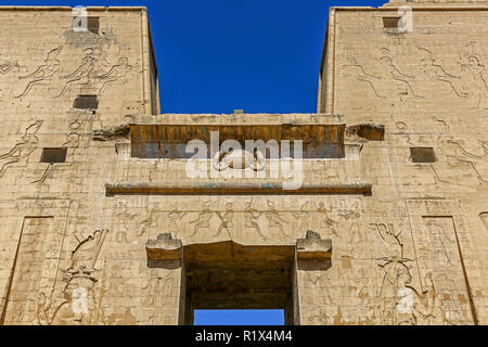 Detail on the First Pylon at the Temple of Edfu is an Egyptian temple located on the west bank of the Nile in Edfu, Upper Egypt, North Africa - Stock Photo