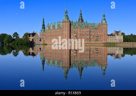 The truly beautiful and majestic 17th-century Frederiksborg Castle (royal residence of King Christian IV) in Hillerod, Denmark - Stock Photo