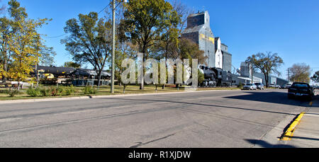 Farmers Elevator with Farmers Union Elevator to the right,  440 SooLine Steam Locomotive. - Stock Photo