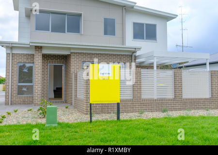 Australian For Sale and For Rent signs outside house, NSW, Australia - Stock Photo